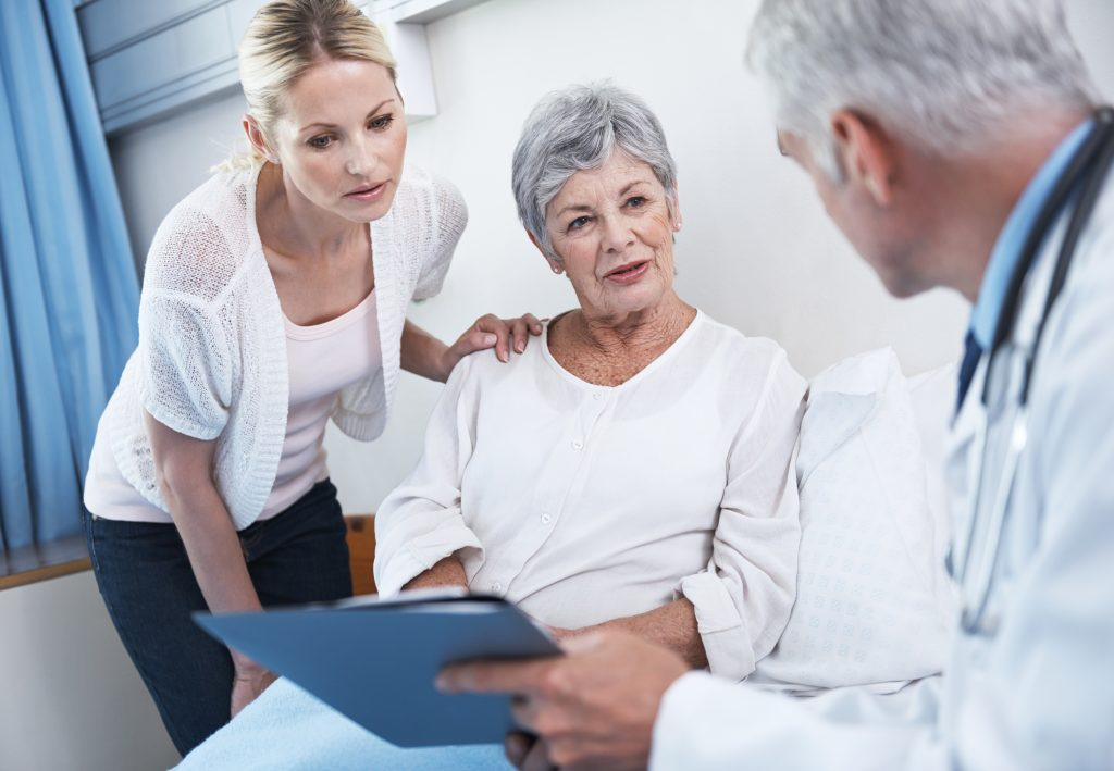 doctor explaining medical results to patient